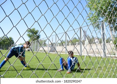 Kids football team is warming to the match