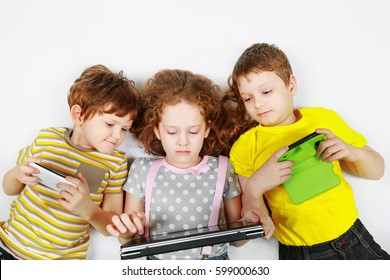 Kids friend playing with smartphone, notebooks. Education concept.