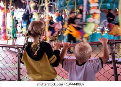 Kids In Front Of Carosel