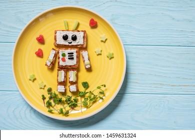 Kids funny breakfast toast look like a cute robot