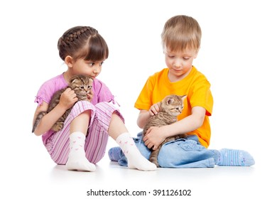 Kids girl and boy stroke kittens