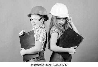 Kids girls planning renovation. Initiative children girls provide renovation their room green background. Child care. Renovation plan. Home improvement. Builder engineer architect. Future profession.
