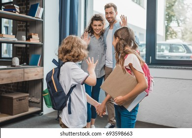 kids going to school and waving to parents