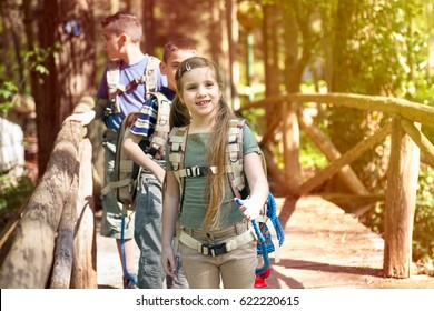 kids in green forest playing,concept of kids vacations and travel