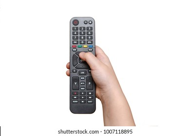 Kid's hand holding the TV remote control on white background