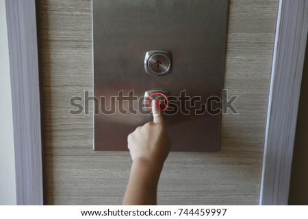 kid's hand press down button of elevator