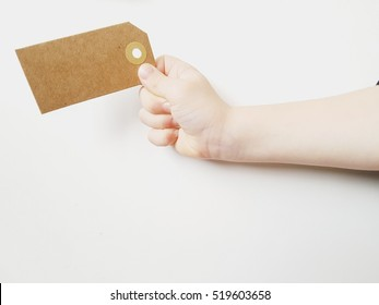 kids hand with tag