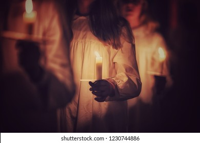 Kids are handling candles in the traditionall dresses. Celebration of Lucia day in Sweden.