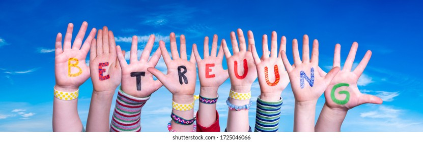 Kids Hands Holding Word Betreuung Means Day Care, Blue Sky