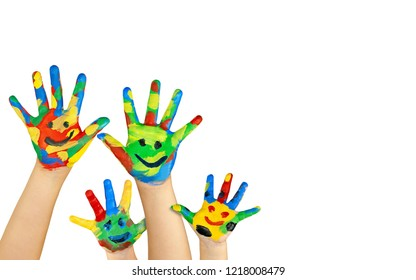 Kids hands painted with smile symbol. Kids having fun & joy concept.