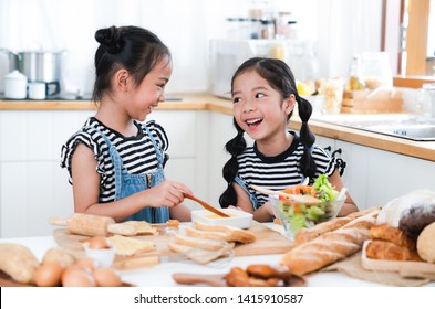 kids happy and fun preparing make the Sandwiches and salads at a kitchen