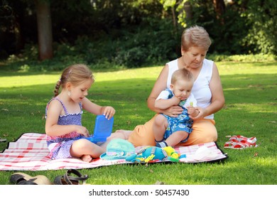 Kids have a small picnic with grandma