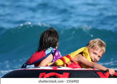 kids having fun on a tow buoy