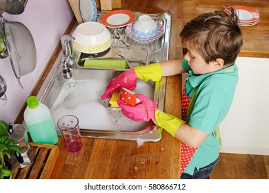 Kids helping with the chores at home, doing the dishes in the kitchen