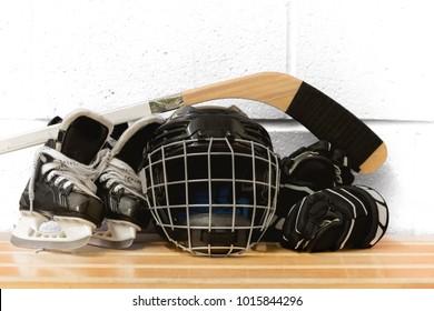 Kid's hockey gear: helmet, stick, gloves, skates