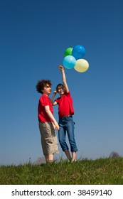 Kids holding balloons, playing outdoor