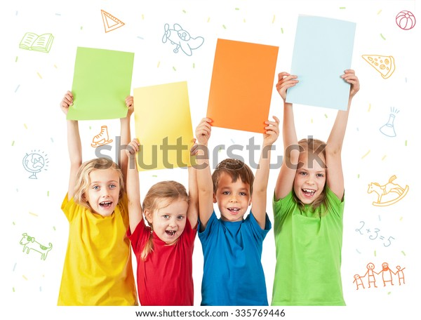 Kids holding colorful sheets with letters isolated on white