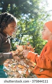 Kids holding leaves