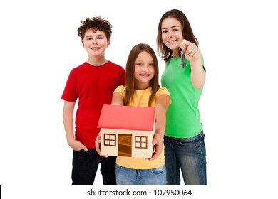 Kids holding model of house isolated on white
