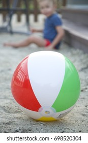Kids inflatable ball and small baby on the background