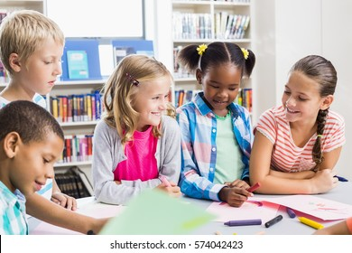 Kids interacting with each other in library at school