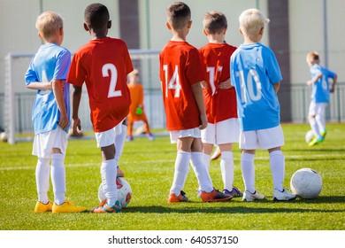 Kids Junior Football Training session. Soccer Training for Kids. Children Practice Soccer on the Pitch