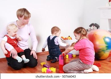 Kids in kindergarten with their teacher
