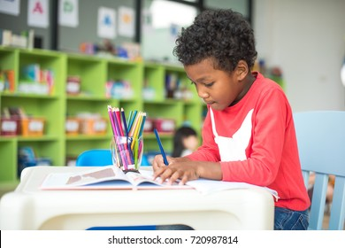 kids kindergartner in group of preschool are in attention of learning drawing subject in classroom and enjoy learning together