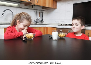 kids in the kitchen eating cereals