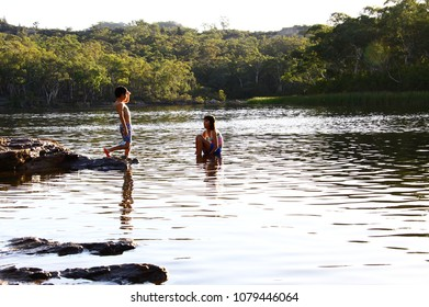 Kids in the lake at Dunns Swamp, NSW, Australia