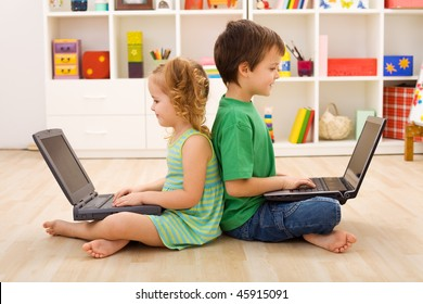 Kids with laptops sitting on the floor - computer generation concept