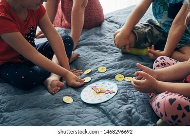 Kids learning how to tell time from clock and set the hands in the correct position. Teaching preschoolers tell time. Candid people, real moments, authentic situations