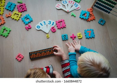 kids learning numbers, boy and girl counting on abacus