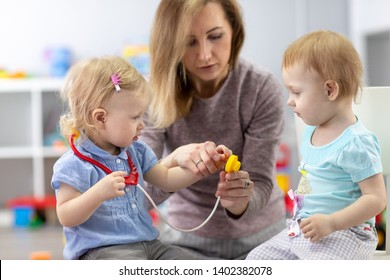 kids learning with nursery teacher are a doctor and patient.