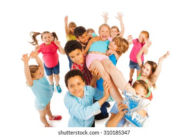 Kids lifting popular classmate and cheering