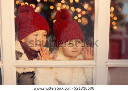 Kids look out window waiting santa stock photo edit now - App that puts santa in your living room ...