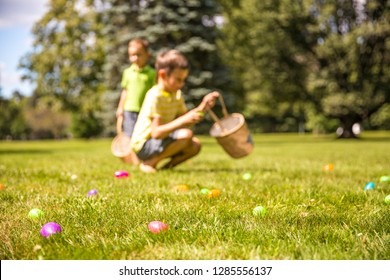 kids looking for easter eggs in the park. easter eggs hunt. Blurred children's silhouettes with baskets in hands. the concept of family fun at Easter.