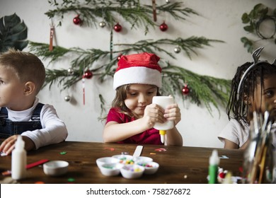 Kids making Christmas DIY projects