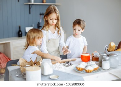 Kids making cookies in the kitchen