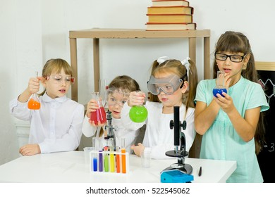 kids making science experiments in laboratory. education