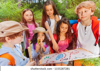 Kids with map on treasure hunt navigation activity