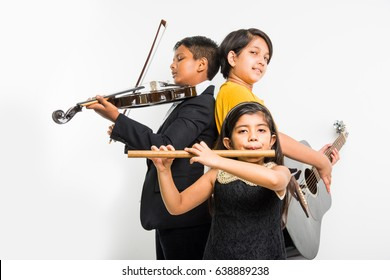 Kids and music concept - Cute little Indian kids playing musical instruments as a team or band, Over white background
