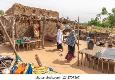 Kids Niger walking and playing in village lifestyle. Living in houses made of mud and sand, in the Sahara and Sahel. West-African culture of Niger.