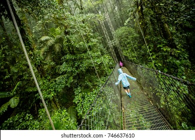 Kids on Canopy Tour through the rainforest in Costa Rica