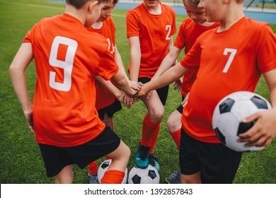 Kids on Football Soccer Team Putting Hands in. Boys Football School Team Huddling. Children Hands Together in a Huddle