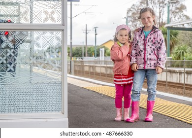 kids on railway station waiting for train