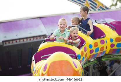 Kids on a thrilling roller coaster ride at an amusement park