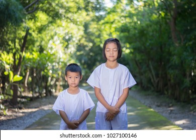 kids on white clothing , practice walking Meditation in forest tree with peace in min
