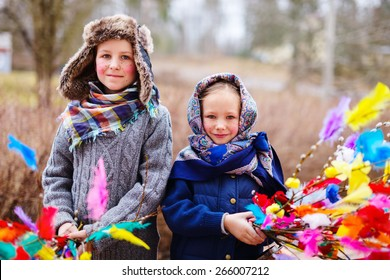 Kids outdoors dressed for Easter traditional celebration in Finland
