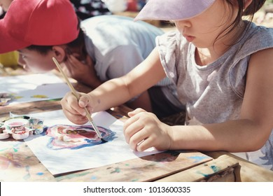 kids painting art outdoor activity, homeschooling montessori education